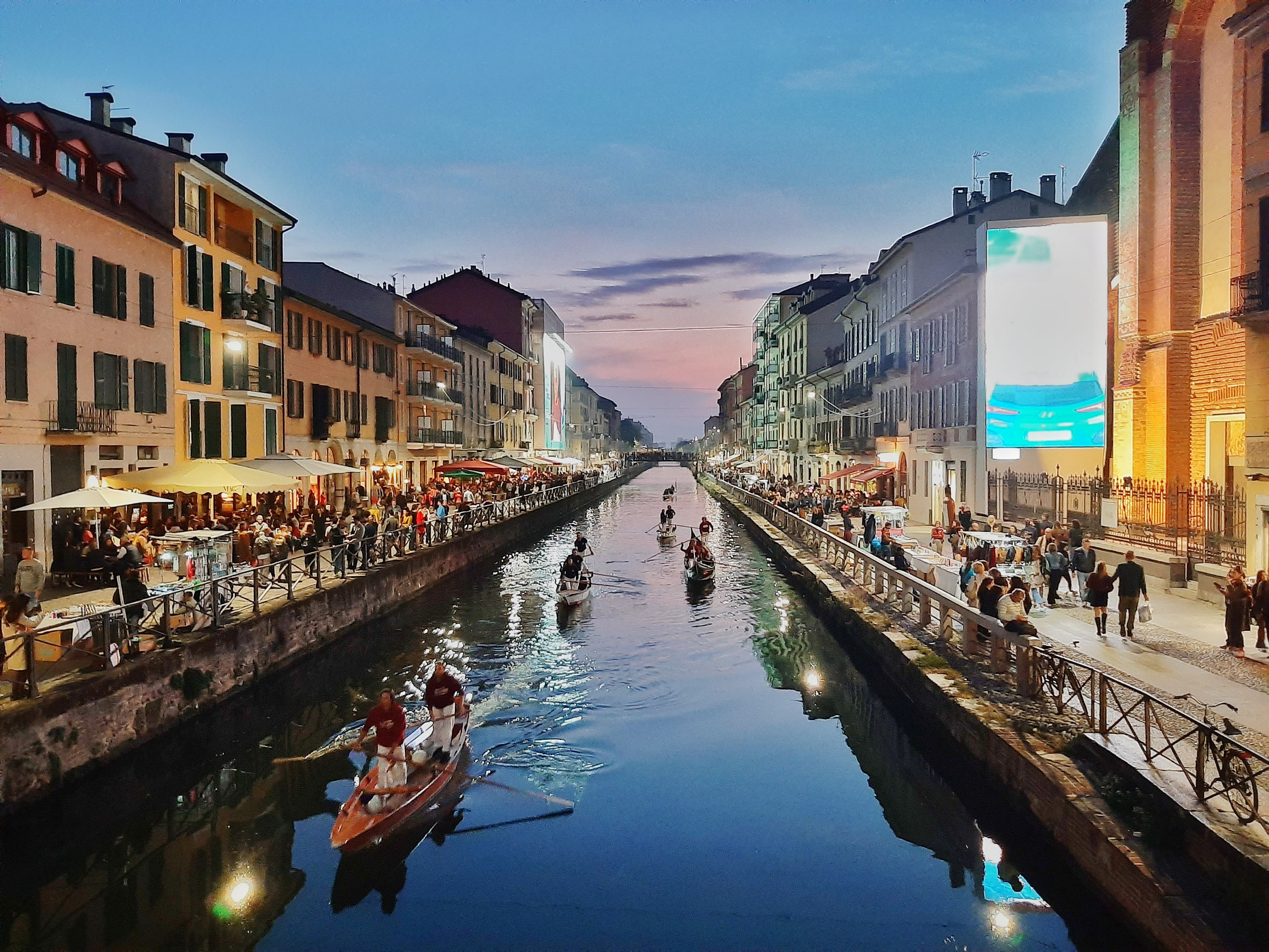 A picture of a river in Milan at dusk.